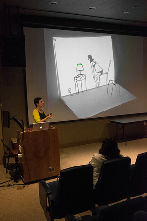 Another small video. The table and lamp are drawn, the chair is wire sculpture, and the projection of the moving female figure casts the chair's shadow on the page. — at Albright College.